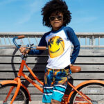 Stylish child wears clothing from Animal Crackers boutique